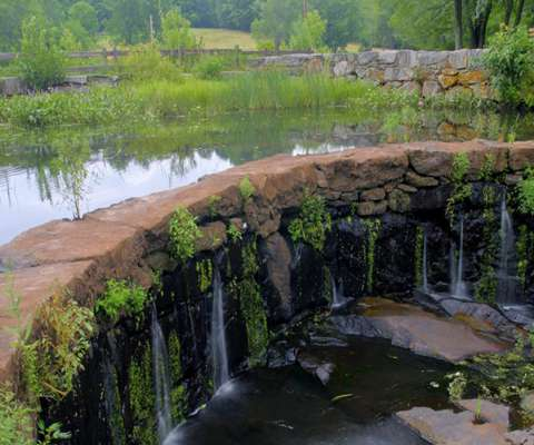 Southford Falls State Park's scenic waterfalls at the southeast end of the Park on the Eight Mile River